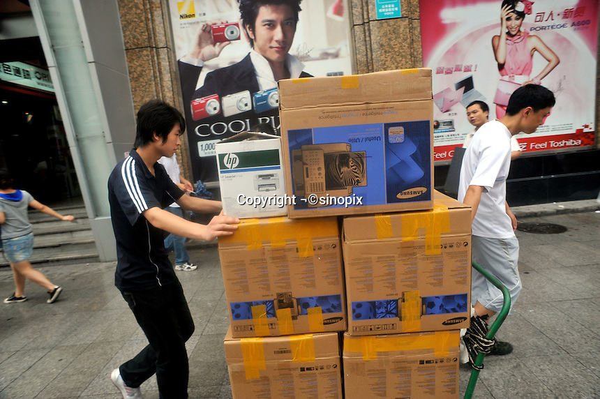 Samsung fax machines and HP printers are moving along a street in Guangzhou, China. The financial crisis won't have too much impact on Chinese consuming market. According to a survey by Nielsen of 50 countries and regions, only 35 percent of Chinese people believed the domestic economy was in a contraction. The figure was the lowest among the 50 world markets..