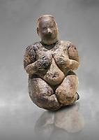 Seated terracotta goddess, probably a sign of fertility. Catalhoyuk Collections. Museum of Anatolian Civilisations, Ankara. Against a gray mottled background