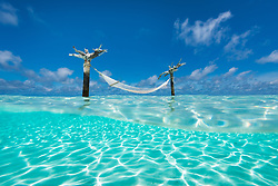 Another perspective on this relaxing escape... this hammock stands on a small sandbar in the lagoon waters of the Indian Ocean.