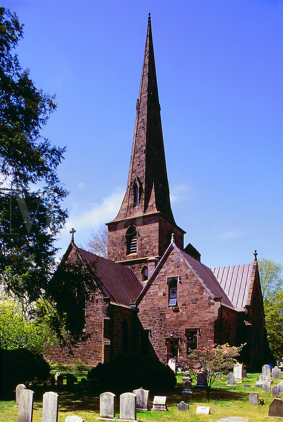 The severe, dramatic exterior architecture and graveyard of the New St. Mary's Episcopal Church (circa 1854). Burlington, New Jersey.