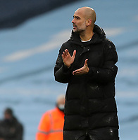 10th January 2021; Etihad Stadium, Manchester, Lancashire, England; English FA Cup Football, Manchester City versus Birmingham City; Manchester City manager Pep Guardiola applauds his players as they lead 3-0