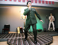 Pictured: An Elvis Presley impersonator from the singer's army period, performs at the Brentwood Hotel, which has been renamed to Heartbreak Hotel for the festival. Friday 22 September 2017<br />