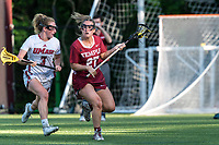 NEWTON, MA - MAY 14: Bridget Whitaker #27 of Temple University looks to pass as Amy Moreau #3 of University of Massachusetts defends during NCAA Division I Women's Lacrosse Tournament first round game between University of Massachusetts and Temple University at Newton Campus Lacrosse Field on May 14, 2021 in Newton, Massachusetts.