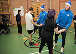 St Johnstone players took some festive cheer to Fairview School in Perth gving out selection boxes and gifts to the pupils… Zander Clark dancing with Holly a secondary school pupil<br />Picture by Graeme Hart.<br />Copyright Perthshire Picture Agency<br />Tel: 01738 623350  Mobile: 07990 594431