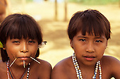 Brazil. Portrait of two Yanomami Indian girls, showing facial decoration (piercing) and beads.