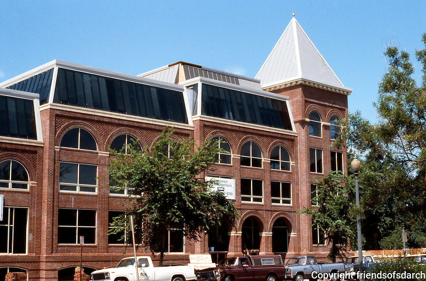 D.C.: Georgetown--New (1985) commercial building, M St. NW. Post-Modern Historicism--form of a Victorian brewery. Photo '85.
