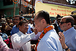 12 March 2013, Kanpur, Uttar Pradesh India: President of the World Bank, Mr Jim Yong Kim is welcomed with garlands of flowers and a forehead tilak to start his visit to the low income suburb of Gwaltoli  on his tour of Kanpur in Uttar Pradesh state, India. Mr.Kim is visiting India  for meetings with local staff, Indian Government Ministers and to inspect projects sponsored by World Bank in regional areas. Picture by Graham Crouch/World Bank
