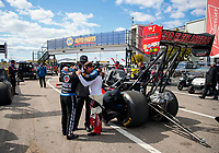 Oct 4, 2020; Madison, Illinois, USA; NHRA top fuel driver Antron Brown (left) and Steve Torrence pray during the Midwest Nationals at World Wide Technology Raceway. Mandatory Credit: Mark J. Rebilas-USA TODAY Sports