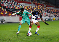 7th November 2020; Brentford Community Stadium, London, England; English Football League Championship Football, Brentford FC versus Middlesbrough; Britt Assombalonga of Middlesbrough challenges Goalkeeper David Raya of Brentford for the ball