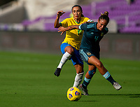 ORLANDO, FL - FEBRUARY 18: Marta #10 of Brazil fights for the ball with Marina Delgado #4 of Argentina during a game between Argentina and Brazil at Exploria Stadium on February 18, 2021 in Orlando, Florida.