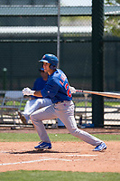 Chicago Cubs infielder Reivaj Garcia (24) follows through on his swing during an Extended Spring Training game against the Los Angeles Angels at Sloan Park on April 14, 2018 in Mesa, Arizona. (Zachary Lucy/Four Seam Images)