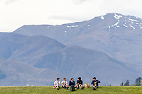 20th November 2020; John Davies Oval, Queenstown, Otago, South Island of New Zealand. New Zealand A versus  West Indies  as school children share lunch in front of the mountains
