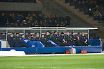 Hertha Berlin 1 Sporting Lisbon 0, 16/12/2010. Olympic Stadium, Europa League. The home team's substitutes concentrate on keeping warm in the sub-zero temperatures as Hertha Berlin take on Sporting Lisbon in the Olympic Stadium in Berlin in a UEFA Europa League group match. Hertha won the match by 1 goal to nil to press to the knock-out round of the cup. 2009/10 was the the first year in which the Europa League replaced the UEFA Cup in European football competition. Photo by Colin McPherson.