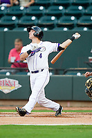 Chris Curley (4) of the Winston-Salem Dash follows through on his swing against the Lynchburg Hillcats at BB&T Ballpark on August 5, 2013 in Winston-Salem, North Carolina.  The Dash defeated the Hillcats 5-0.  (Brian Westerholt/Four Seam Images)