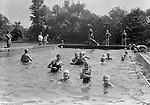 East McKeesport PA:  Girl Scouts playing in the swimming pool at Camp Youghahela.