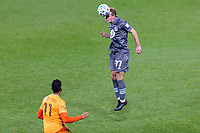 ST PAUL, MN - OCTOBER 18: Chase Gasper #77 of Minnesota United FC heads the ball during a game between Houston Dynamo and Minnesota United FC at Allianz Field on October 18, 2020 in St Paul, Minnesota.