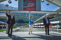 "Switzerland. Canton Ticino. Camorino. Ceneri Base Tunnel (CBT). Official opening ceremony. (Left to right) Dieter Schwank (CEO Alptransit Gothard AG), the anchorwoman from the swiss italian television, Vincent Ducrot (CEO CFF FFS SBB). Both men are giving the go ahead for the trains. The Ceneri Base Tunnel (CBT) (Italian: Galleria di base del Monte Ceneri) is a railway base tunnel in Canton Ticino. It passes under Monte Ceneri between Camorino in the Magadino Flat and Vezia near Lugano, and bypasses the former high-altitude rail route through the Monte Ceneri Tunnel. It is composed of two single-track tunnels, each 15.4 km long. It is another part of the New Railway Link through the Alps (NRLA) project. The impact will be significant on international traffic with shorter time trips. The opening of the Ceneri tunnel also means a transport revolution for the southern canton of Ticino. Regional rail lines will be upgraded, and some reckon the change could lead to the creation of a ""Ticino City"" – one big urban sprawl across the canton. 4.09.2020  © 2020 Didier Ruef"