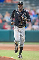 Omaha Storm Chasers center fielder Paulo Orlando (16) heads to the dugout during the Pacific Coast League game against theOklahoma City RedHawks  at Chickashaw Bricktown Ballpark on June 23, 2013 in Oklahoma City ,Oklahoma.  (William Purnell/Four Seam Images)