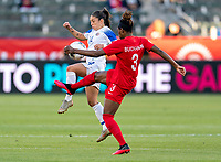CARSON, CA - FEBRUARY 07: Priscila Chinchilla #14 of Costa Rica collides with Kadeisha Buchanan #3 of Canada during a game between Canada and Costa Rica at Dignity Health Sports Park on February 07, 2020 in Carson, California.