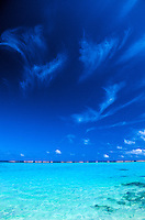Deep blue sky, whispy clouds and turquois blue ocean water. Photo taken on the island of oahu.