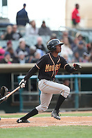 Raimel Tapia (15) of the Modesto Nuts bats during a game against the Lancaster JetHawks at The Hanger on April 25, 2015 in Lancaster, California. Lancaster defeated Modesto, 5-4. (Larry Goren/Four Seam Images)