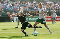 Tiffeny Milbrett (15) shoots the ball ahead of Niki Cross (19). FC Gold Pride tied the St. Louis Athletica 1-1 at Buck Shaw Stadium in Santa Clara, California on August 9, 2009.
