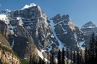 Mounts Bowlen Tonsa, & Perren rise high above Moraine Lake in the Valley of the Ten Peaks, Banff National Park at sunset