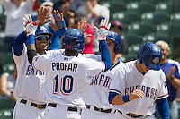 Round Rock Express shortstop Jurickson Profar #10 is greeted by teammates (L to R) Engle Beltre, Chris McGuiness, and Mike Olt after he blasted a grand slam home run the seventh inning of the Pacific Coast League baseball game against the New Orleans Zephyrs in the on April 21, 2013 at the Dell Diamond in Round Rock, Texas. Round Rock defeated New Orleans 7-1. (Andrew Woolley/Four Seam Images)