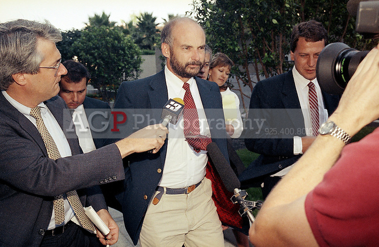 Jul 26, 1990 - Long Beach, California, USA - Former Exxon Valdez Capt. Joseph Hazelwood is surrounded by reporters as he leaves his relicensing hearing in Long Beach, Calif. on Wednesday, July 26, 1990. The Coast Guard suspended Hazelwood's captain's license for one year, with three of those months covered by a probation period. The Coast Guard dismissed two misconduct and negligence charges against him..(Credit Image:  Alan Greth)