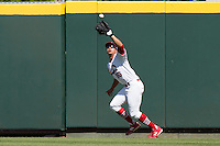 David Popkins (16) of the Springfield Cardinals catches a fly ball to right field during a game against the Tulsa Drillers at Hammons Field on May 4, 2014 in Springfield, Missouri. (David Welker/Four Seam Images)