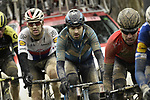 Riders caked with mud from the white dirt roads of Tuscany give chase during the 2018 Strade Bianche Men Elite NamedSport race running 184km from Siena to Siena, Tuscany, Italy. 3rd March 2018.<br /> Picture: LaPresse/Fabio Ferrari | Cyclefile<br /> <br /> <br /> All photos usage must carry mandatory copyright credit (© Cyclefile | LaPresse/Fabio Ferrari)