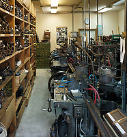 Open shelves full of tooling and machinery in the workshop of the Dale Guild Foundry.