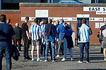 Kilmarnock fans gathering outside the East Stand. Kilmarnock 2 Ayr United 0, Scottish Championship, August 2nd 2021. Following Kilmarnock's relegation in 2020-21, the first game of the new season is the Ayreshire Derby, the first league match between the teams in 28 years. Due to relaxation of Covid restrictions the match was played in front of a crowd of 3200 Kilmarnock fans. The game was shown live on BBC Scotland.