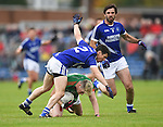 Keelan Sexton of  Kilmurry Ibrickane in action against Sean Chaplin and John Galvin of Cratloe during their senior football final replay at Cusack park. Photograph by John Kelly.