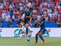 PARIS,  - JUNE 28: Valérie Gauvin #13 goes up for a header with Crystal Dunn #19 during a game between France and USWNT at Parc des Princes on June 28, 2019 in Paris, France.