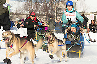 Jessica Klejka and Iditarider Terrie Hanke take the turn on Cordova Street during the 2019 ceremonial start of the Iditarod in downtown Anchorage, Alaska on Saturday March 2.<br /> <br /> Photo by Jeff Schultz/  (C) 2019  ALL RIGHTS RESERVED