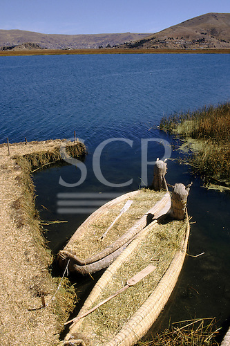 Lake Titicaca, Peru. Reed boats with fantastic animal figureheads at the floating island of Uros.