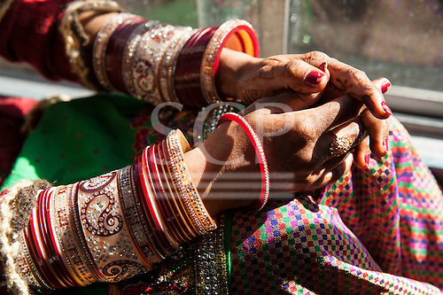 Shimla, Himachal Pradesh, India. A newlywed bride with traditional rows of bangles aboard the Himalayan Queen, the Toy Train from Shimla to Kalka.