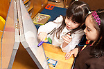 Education Preschool two girls playing together writing with markers on dry erase board