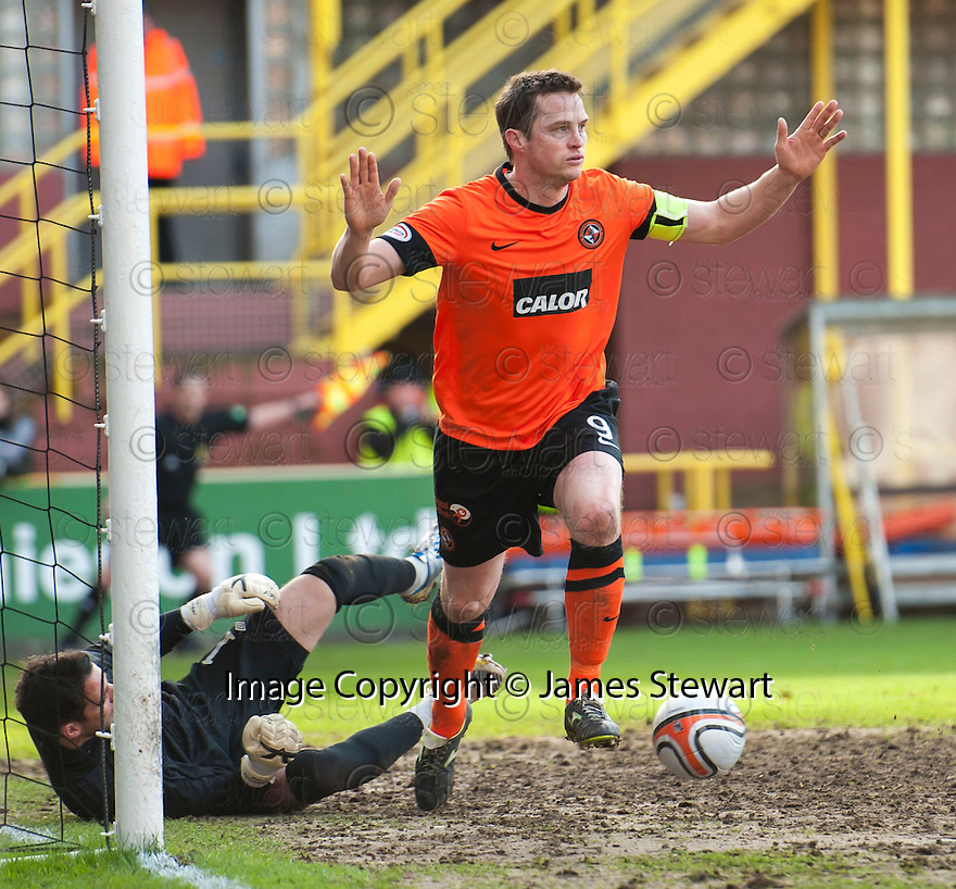 United's Jon Daly celebrates after he scores united's second.