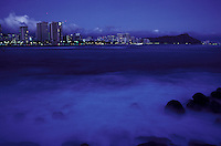 View of Waikiki at night from magic Island, with Diamond Head in the background