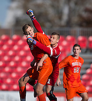 Drew Ranahan (3) of Virginia Tech collides with Fabien Otte (1) of North Carolina State during the game at Ludwig Field in College Park, MD. Virginia Tech defeated North Carolina State, 3-2, in the ACC tournament play-in game.
