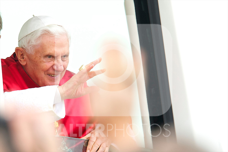 Pope Benedict XVI is welcomed by Prince Felipe  and Princess Letizia upon his arrival at the Lavacolla airport, in Santiago de Compostela, Spain..Photo: Billy Chappel / ALFAQUI