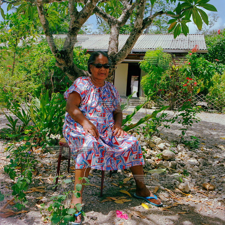 A portrait of Zilla Demauna. Zilla (born 1925) was 18 when Japanese forces deported many local villagers during the Pacific War of World War II (WW2). She stayed in the bush, ate bush food and stole pumpkins from the Japanese. She remembers that the beautiful Nauruan girls were ordered to 'take care' of the Japanese.