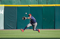 Lehigh Valley IronPigs center fielder Darnell Sweeney (24) attempts to catch a fly ball that fell in for a hit during a game against the Buffalo Bisons on July 9, 2016 at Coca-Cola Field in Buffalo, New York.  Lehigh Valley defeated Buffalo 9-1 in a rain shortened game.  (Mike Janes/Four Seam Images)