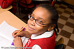 K-8 Parochial School Bronx New York Grade 3 mathematics lesson on measurement using rulers portrait of girl wearing glasses horizontal