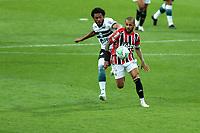 4th October 2020; Couto Pereira Stadium, Curitiba, Parana, Brazil; Brazilian Series A, Coritiba versus Sao Paulo;  Sabino of Coritiba and Daniel Alves of Sao Paulo chase a through ball