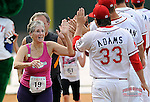 Greenville Drive players greet runners at the finish line of the Spirit of Boston Run on Monday, April 21, 2014, at Fluor Field at the West End in Greenville, South Carolina. The event was to honor the Boston Marathon and to raise funds for the City of Greenville Community Youth Baseball. (Tom Priddy/Four Seam Images)