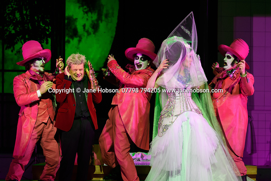 "EMBARGOED UNTIL 23:00 FRIDAY 18 OCTOBER 2019: London, UK. 16.10.2019.  English National Opera presents ""The Mask of Orpheus"", by Sir Harrison Birthwhistle, libretto by Peter Zinovieff, at the London Coliseum, in its first London restaging in the 30 years since its premiere, coinciding with the celebration of Sir Harrison's 85th birthday. Directed by Daniel Kramer, with lighting design by Peter Mumford, set design by Lizzie Clachan and costume design by Daniel Lismore. Picture shows: Peter Hoare (Orpheus the Man) and Marta Fontanals-Simmons (Eurydice the Woman), with David Ireland, William Morgan, Simon Wilding (Judges of the Dead). Photograph © Jane Hobson."