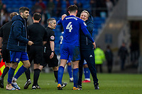 Cardiff City manager Neil Warnock celebrates with his captain and match-winner Sean Morrison at full time of the Sky Bet Championship match between Cardiff City and Middlesbrough at the Cardiff City Stadium, Cardiff, Wales on 17 February 2018. Photo by Mark Hawkins / PRiME Media Images.
